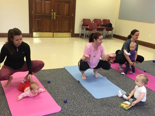 Mothers and babies from Fort Thomas area take yoga.