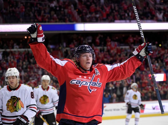 Washington Capitals center Nicklas Backstrom, center, of Sweden, celebrates his goal during the first period of an NHL hockey game against the Chicago Blackhawks, Wednesday, Dec. 6, 2017, in Washington. (AP Photo/Nick Wass)