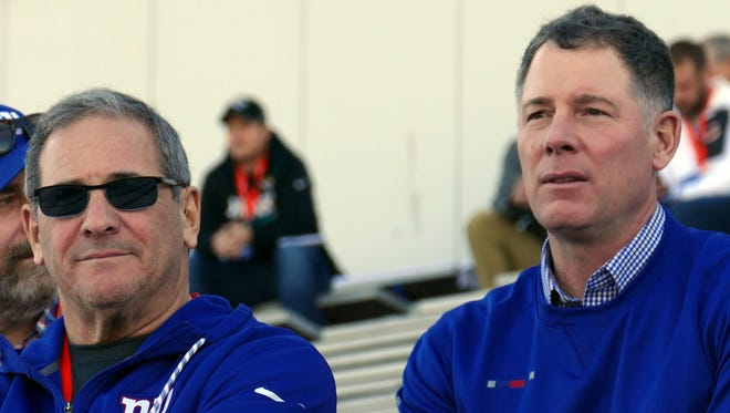 New York Giants general manager Dave Gettleman, left, and new head coach Pat Shurmur watch practice at the Senior Bowl on Wednesday, Jan. 25, 2018, in Mobile, Ala. Shurmur will be formally introduced as the 18th head coach in franchise history Friday in East Rutherford.
