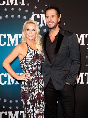 Luke Bryan and wife Caroline on the red carpet at Bridgestone Arena, on Dec. 3, 2013, in Nashville.