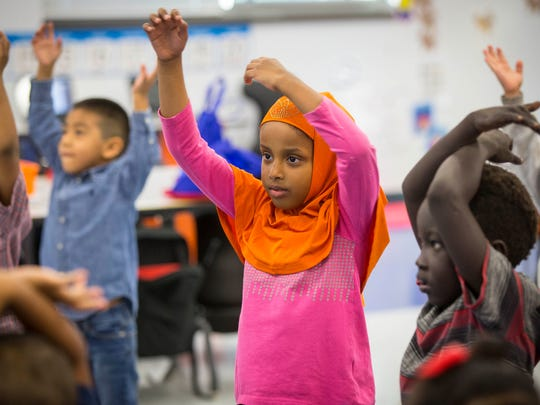 Alisha Sinclair's kindergarten class at Edmunds Academy in Des Moines practices yoga at the beginning of the school day, Oct. 13, 2016. Here, Sumaya Gaas practices a pose.