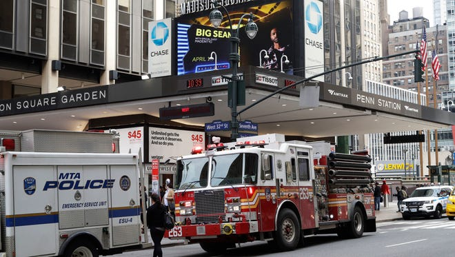 Police and fire vehicles respond to news of a train derailment at Penn Station, Monday, April 3, 2017, in New York. New Jersey Transit says one of its trains derailed while pulling into the station at a slow speed. There were no immediate reports of serious injuries, but New Jersey Transit and Amtrak had service delays.