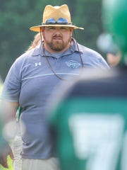 Parkside head coach Brendan Riley watches over his