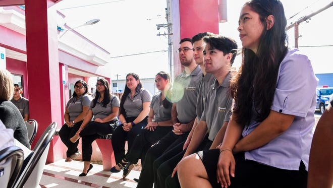 """University of Guam students, Guam Community College students and others listen to a presentation during the official grand opening of the Community First Guam Federal Credit Union's Mangilao branch on Friday, Feb. 16, 2018. The branch outlet is being touted as the island's """"first student-run credit union,"""" operated by the student interested in gaining knowledge and experience in the world of finance. The students were able to gain some initial experience after a soft opening was held for the outlet last month on Jan. 16."""
