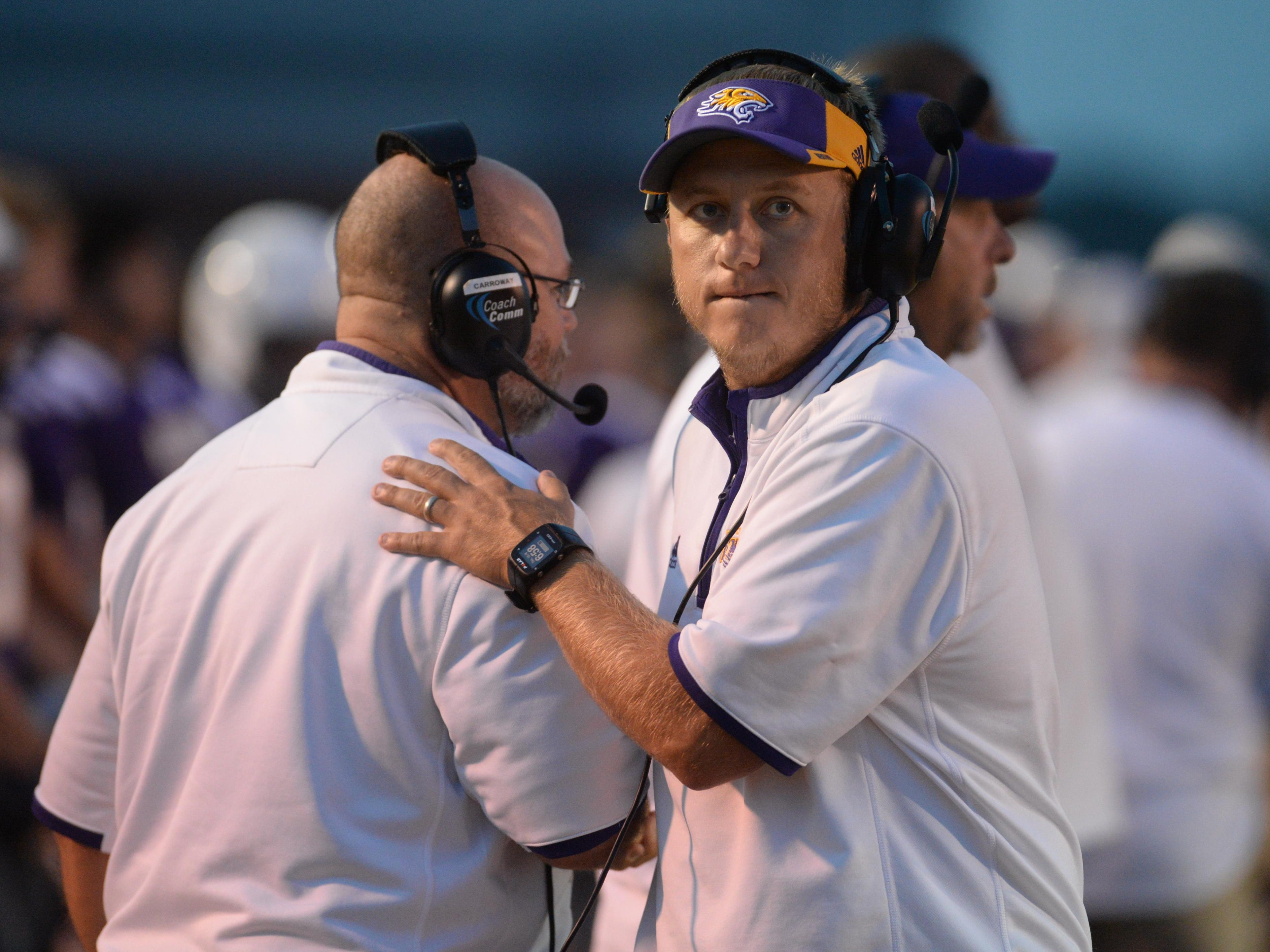 Benton head coach Reynolds Moore walks the sidelines as his team takes on Minden.