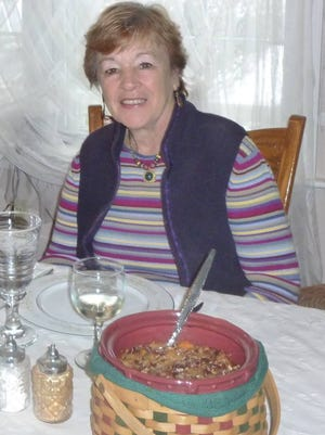 Emma Grube at Thanksgiving meal with her sweet potato casserole