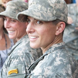 Capt. Kristen Griest, right, and 1st Lt. Shaye Haver graduate from Ranger School at Fort Benning in Georgia on Aug. 21, 2015.