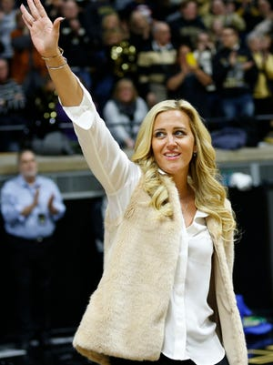 Former Purdue great Katie Douglas waves to the audience as she is introduced at the halftime of the Boilermakers game with Indiana Sunday, January 10, 2016, at Mackey Arena. Purdue beat Indiana 63-53.
