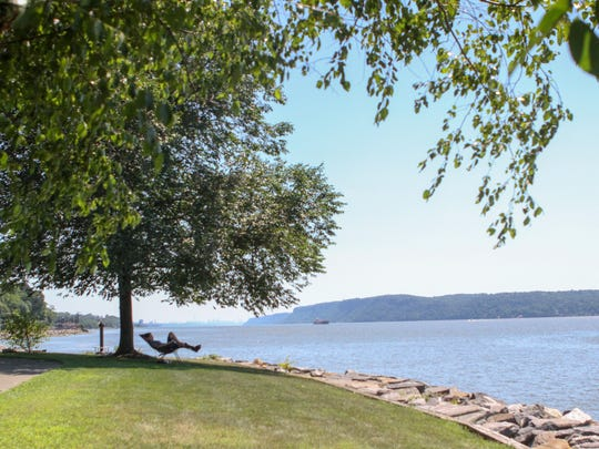 A visitor finds some shade in Irvington at the Scenic Hudson Park, which is part of both the Westchester RiverWalk and the Hudson River Greenway Water Trail.