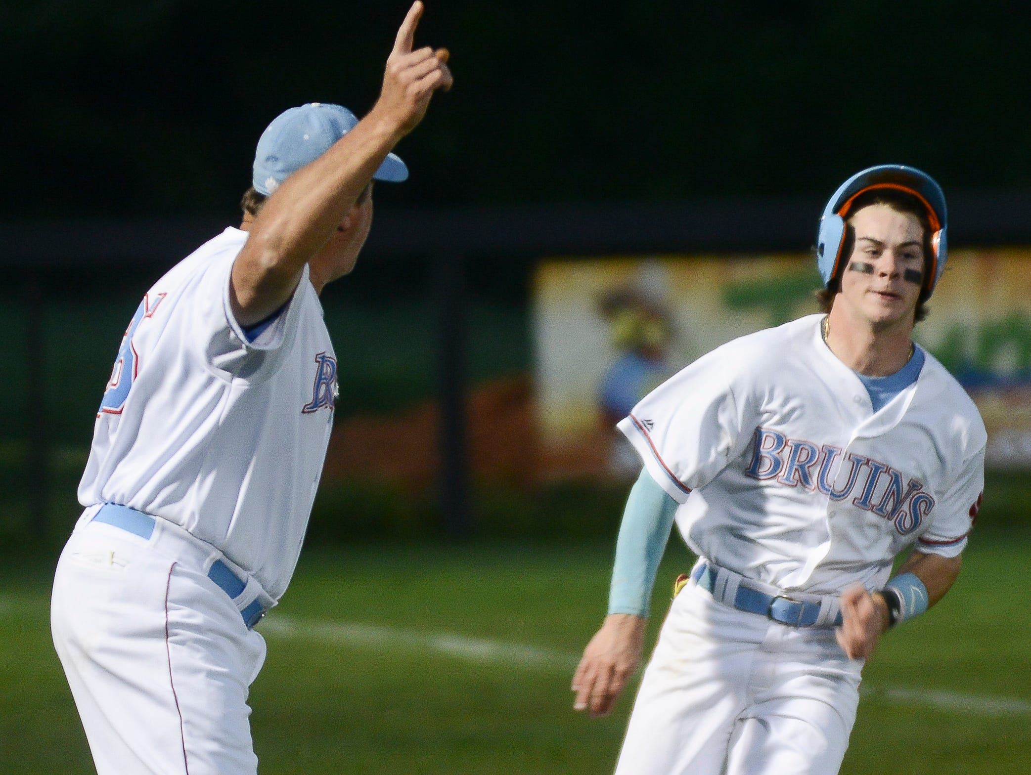 USJ's Logan Carey rounds third base to head home in a game against Tipton-Rosemark earlier this season.
