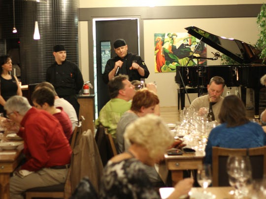 Chef Eric Nelson describes one of the courses to diners at a Pairings dinner at Willamette Valley Vineyards.