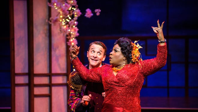 """Chris Klopatek (Ko-Ko) and Jamecia Bennett (Katisha) try to get on the same page in Skylight Music Theatre's production of """"Hot Mikado,"""" which winds up its run Oct. 15."""