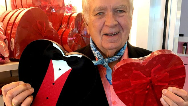 Carleton Varney holds boxes of Valentine' s candy at a See's Chocolates shop in Los Angeles.