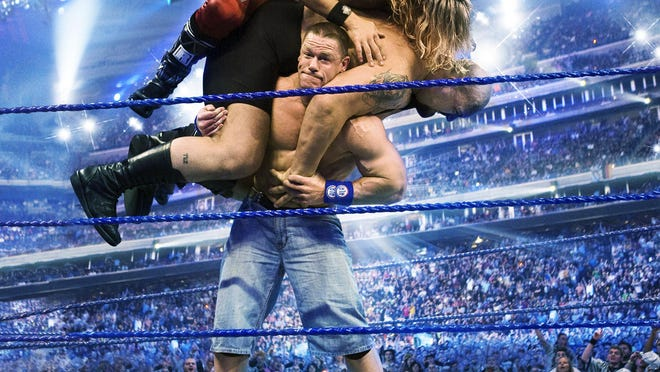 """John Cena will the WWE world heavyweight championship against Randy Orton, Kane and Roman Reigns in a fatal four-way match at the """"Battleground"""" pay-per-view event next Sunday."""