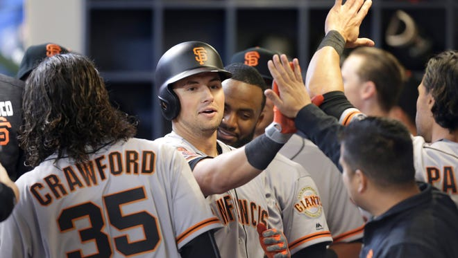 John Jay graduate and second baseman of the San Francisco Giants celebrates after hitting a solo home run in the eighth inning against the Milwaukee Brewers on Opening Day at Miller Park on April 04, 2016 in Milwaukee, Wisconsin. (Photo by Mike McGinnis/Getty Images)