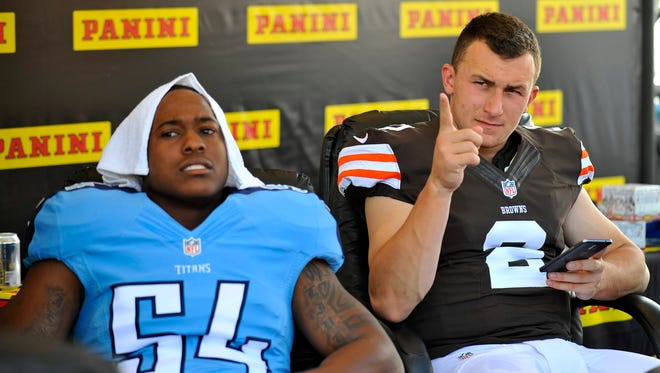 Titans linebacker Avery Williamson, left, and Browns quarterback Johnny Manziel take a break during the 2014 NFLPA Rookie Premiere event at the Los Angeles Memorial Coliseum.