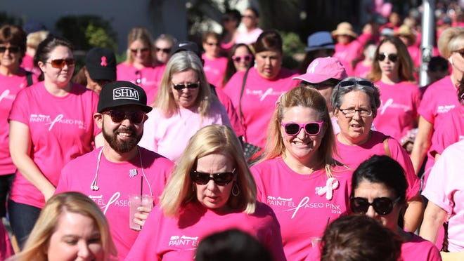 People walk in the Desert Cancer Foundation's annual Paint El Paseo Pink event in Palm Desert on Oct. 11, 2014.