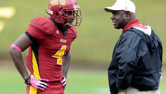 Tuskegee Head Coach Willie Slater talks to wide recover Kaleep Williams during the game at Cleve Abbott Stadium in Tuskegee, Ala., on Saturday, Oct. 19, 2013. (Montgomery Advertiser, Amanda Sowards)