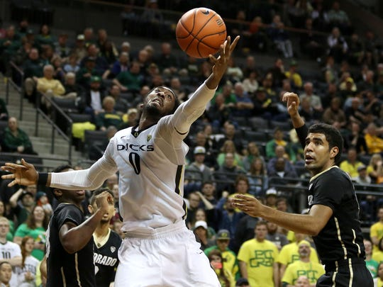 Oregon's Dwayne Benjamin (0) reaches for the ball during their game with Colorado on Wednesday, Feb. 18 , 2015, in Eugene, Ore.