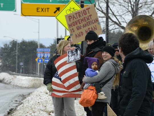 Demonstrators line Williston Road in front of Staples