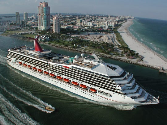 The Carnival Victory is seen sailing past Miami Beach.