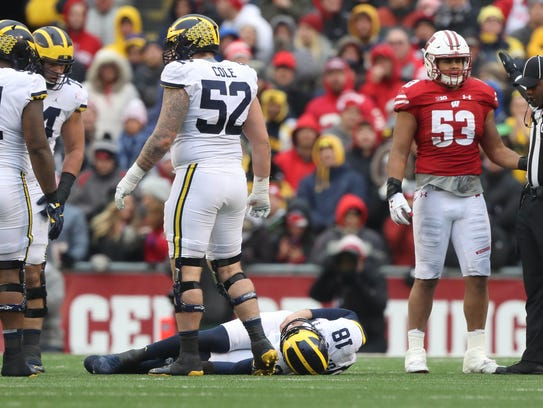 Michigan's Brandon Peters is hurt during the third