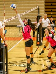 Brighton's Sarah Whitton tips the volleyball over the