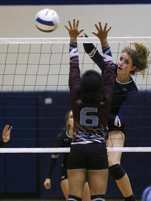 Piedra Vista's Courtney Moore gets a kill against Ganado, Ariz., on Friday during the Piedra Vista Invitational at the Jerry A. Conner Fieldhouse in Farmington.