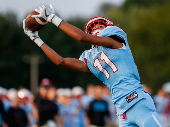 Winston Quinn, of Glendale, makes the catch for a touchdown during the Falcons game versus Lebanon action at Glendale High School on Friday, Sept. 8, 2017.