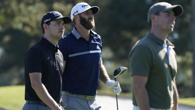 After only a 30-minute break between rounds, the grouping of Patrick Cantlay (from left), Dustin Johnson and Rory McIlroy took advantage of their familiarity with August National Golf Club on Friday. The three players combined to go 14-under par in their second rounds to take prominent places on the leaderboard heading into the weekend.