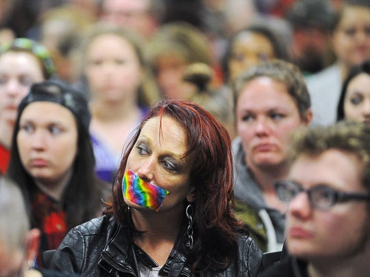 Sarah Gran, of Sioux Falls, looks on during the Sioux