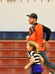 Jason Clark, of Seven Valleys, runs laps with his daughter