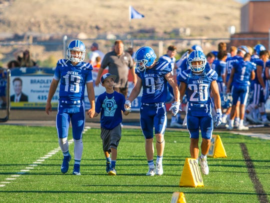 Maddux Alofipo joins Dixie High as an honorary captain