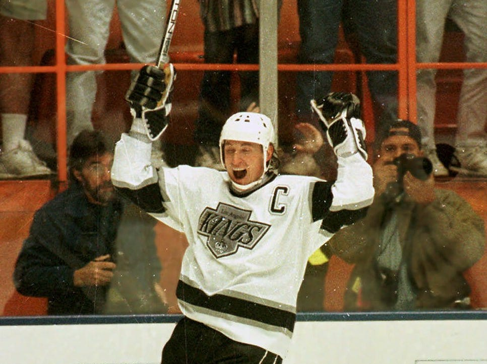 Gretzky, celebrating his record 802nd goal, won three NHL scoring titles with the Kings and totaled 918 points. He was traded to the St. Louis Blues in 1996.