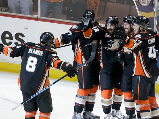 Members of the Anaheim Ducks celebrate Mathieu Perreault's goal during the second period in Game 5 of an NHL hockey second-round Stanley Cup playoff series against the Los Angeles Kings in Anaheim, Calif., Monday, May 12, 2014. (AP Photo/Chris Carlson)
