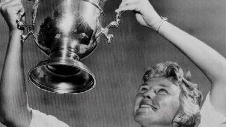 1964: Mickey Wright sports her fourth U.S. Open Women's Golf Championship trophy. She won 13 major championships and 82 pro tour events. (Getty Images)