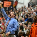 Bill Ackerman, left, spent 18 years building the West York boys' basketball program into a winner. Here, he celebrated the team's 44-38 victory over York Suburban in the 2008 YAIAA title game.