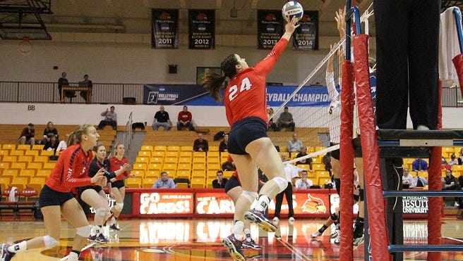 Shippensburg's Taylor Gottshall (24) tips the ball over the net in an NCAA Atlantic Regional volleyball match Thursday. The Lady Raiders fell 3-1 to Gannon to end their season.