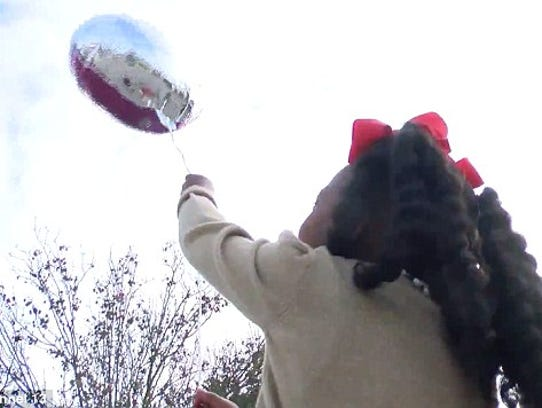 Kr'ani launches her balloon with a note to Santa, Lafayette,