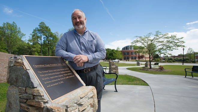 Mauldin Community Development Director Van Broad stands at Mauldin's Veterans Memorial walkway on Friday, April 15, 2016. Broad is leading the effort to create a sense of downtown around East Butler Road area.