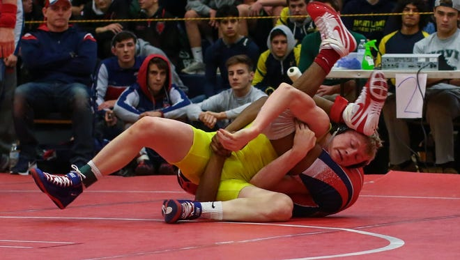 Kyle Kantola (yellow) won his 150th career match to help Hartland to its 18th consecutive district title on Wednesday night