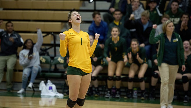 Reynolds' Melissa Cavagnini celebrates a big point Tuesday night.