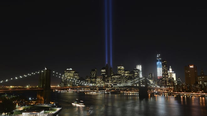 In this Sept. 11, 2012, file photo, The Tribute in Light lights up lower Manhattan in New York. Plans are back on to beam twin columns of light into the Manhattan sky to represent the World Trade Center during this week's anniversary of the 9/11 terror attacks. The Tunnel to Towers Foundation announced Aug. 14 that it is working on plans to shine the twin beams during its alternative 9/11 ceremony.