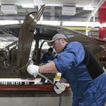 In this March, 2014 photo, an assembly line worker works on a 2015 Chrysler 200 automobile at the Sterling Heights Assembly Plant in Sterling Heights.