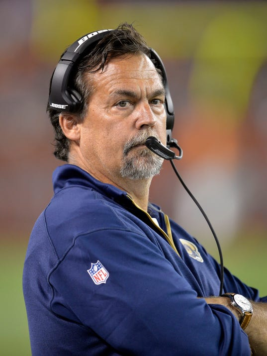 St. Louis Rams head coach Jeff Fisher watches from the sidelines in the third quarter of a preseason NFL football game against the Cleveland Browns Saturday, Aug. 23, 2014, in Cleveland. (AP Photo/David Richard)