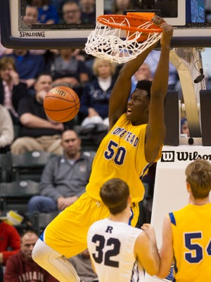 Homestead High School senior Caleb Swanigan (50) slam dunks the ball during the second half of the Class 4A boys' basketball state finals, Saturday, March 28, 2015 in Indianapolis. Homestead High School won in overtime 91-90.