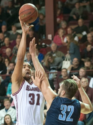 Belarmine Knights center-forward Yasin Kolo puts up a shot over the outstretched arms of Northwood Timberwolves center Casey Boyle. 13 November 2015