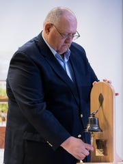 Jim Tucker, a victim of the Tucson shooting, rings a bell for the victims and survivors during a five year memorial service at Banner University Medical Center Tucson on Jan. 8, 2016.