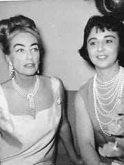 "Actress Joan Crawford with reporter Taris Savell, who interviewed the star on the set of ""Hush Hush Sweet Charlotte"" in June 1964."