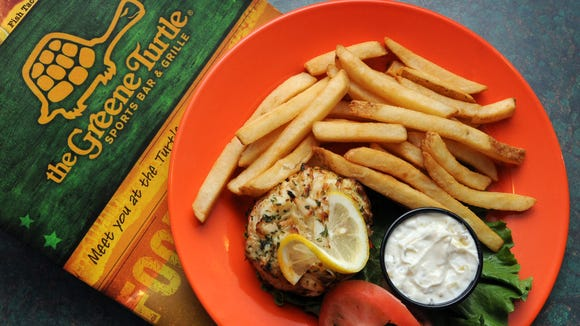 The crab cake made with jumbo lump crabmeat is served with fries at The Greene Turtle Sports Bar & Grille.